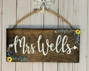 Sign with teacher's name as gift